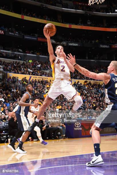 Lonzo Ball of the Los Angeles Lakers goes to the basket against the Denver Nuggets on November 19 2017 at STAPLES Center in Los Angeles California...