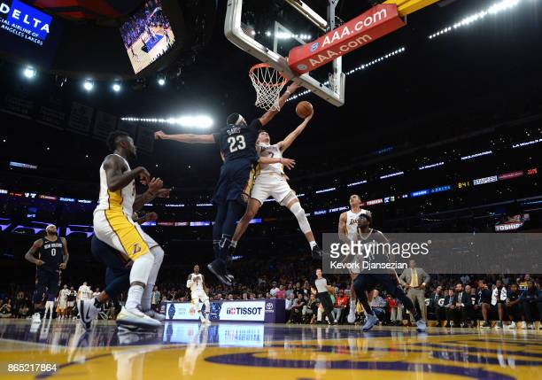 Lonzo Ball of the Los Angeles Lakers goes up for layup against Anthony Davis of the New Orleans Pelicans during the second half at Staples Center...