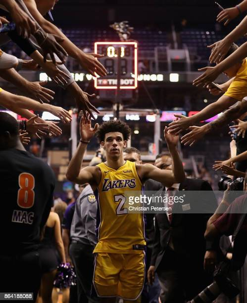 Lonzo Ball of the Los Angeles Lakers high fives fans as he walks off the court following the NBA game against the Phoenix Suns at Talking Stick...