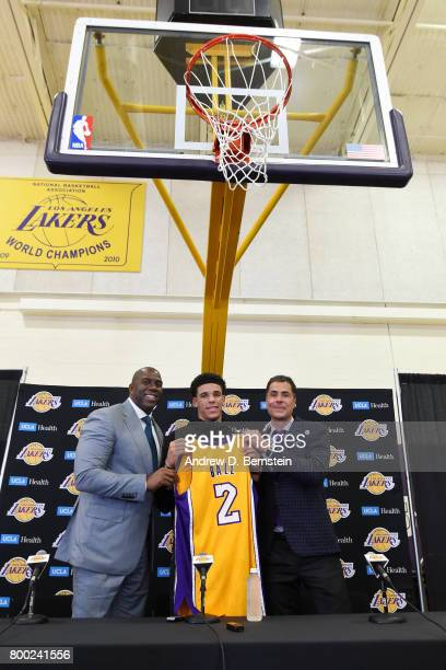 Lonzo Ball of the Los Angeles Lakers holds his jersey as he poses for a picture with President of Basketball Operations for the Los Angeles Lakers...