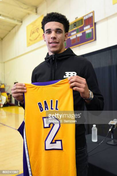 Lonzo Ball of the Los Angeles Lakers holds his jersey as he poses for a picture following a press conference after being introduced as the number 1...