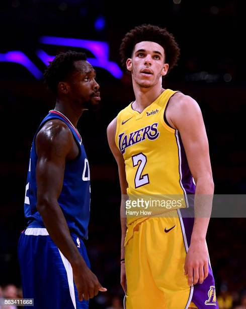 Lonzo Ball of the Los Angeles Lakers is guarded by Patrick Beverley of the LA Clippers during the first half of the Los Angeles Lakers home opener at...