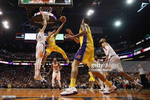 Lonzo Ball of the Los Angeles Lakers lays up a shot against Dragan Bender of the Phoenix Suns during the second half of the NBA game at Talking Stick...