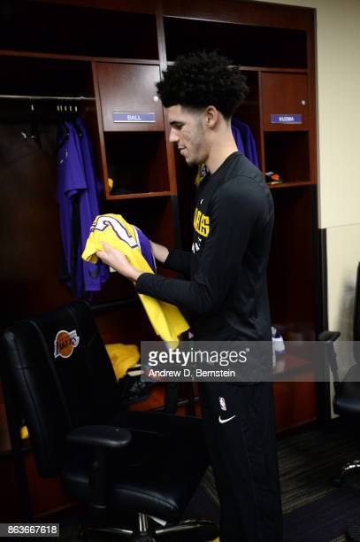 Lonzo Ball of the Los Angeles Lakers looks at his uniform before the game against the LA Clippers on October 19 2017 at STAPLES Center in Los Angeles...