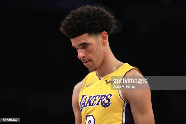 Lonzo Ball of the Los Angeles Lakers looks on during the first half of a preseason game against the Denver Nuggets at Staples Center on October 2...