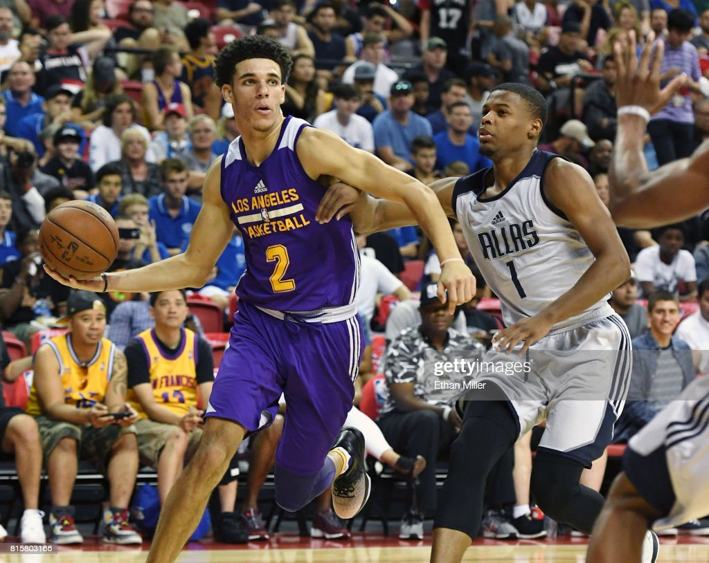 Lonzo Ball #2 of the Los Angeles Lakers looks to pass the ball as he drives against Dennis Smith Jr. #1 of the Dallas Mavericks during a semifinal game of the 2017 Summer League at the Thomas & Mack Center on July 16, 2017 in Las Vegas, Nevada. Los Angeles won 108-98.