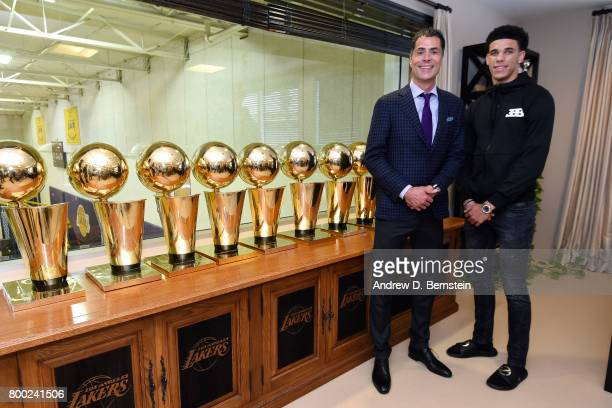 Lonzo Ball of the Los Angeles Lakers poses for a picture with Los Angeles Lakers General Manager Rob Pelinka following a press conference to...