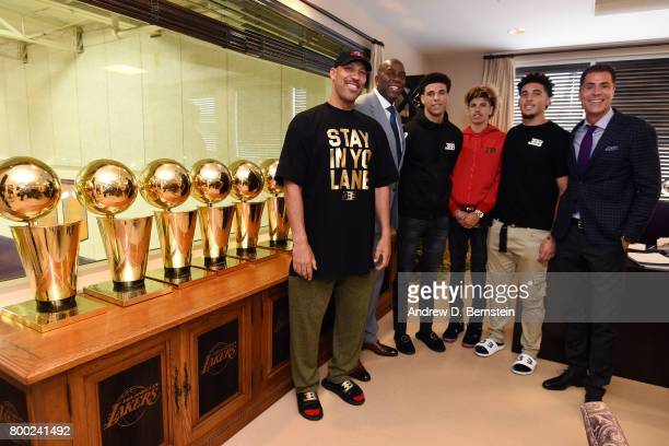 Lonzo Ball of the Los Angeles Lakers poses for a picture with President of Basketball Operation of the Los Angeles Lakers Magic Johnson General...