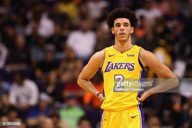 Lonzo Ball of the Los Angeles Lakers reacts on the court during the first half of the NBA game against the Phoenix Suns at Talking Stick Resort Arena...
