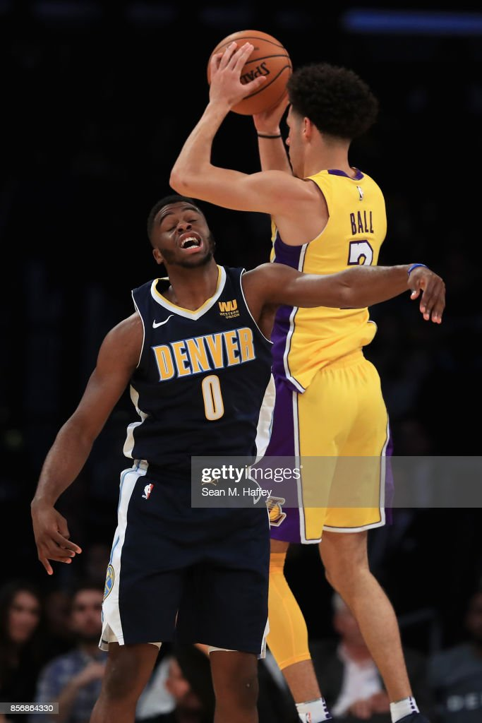 Lonzo Ball #2 of the Los Angeles Lakers rebounds past Emmanuel Mudiay #0 of the Denver Nuggets during the first half of a preseason game at Staples Center on October 2, 2017 in Los Angeles, California.