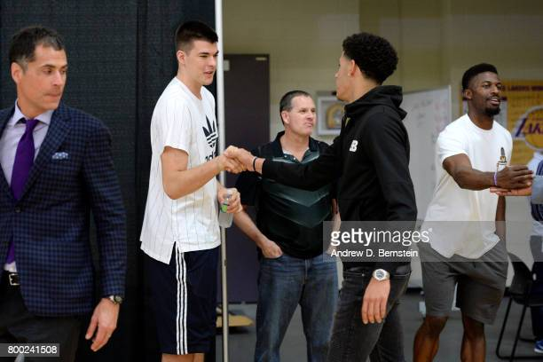 Lonzo Ball of the Los Angeles Lakers shakes hands with Ivica Zubac of the Los Angeles Lakers following a press conference to introduce Los Angeles...