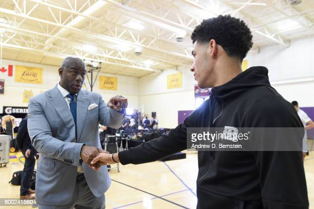 Lonzo Ball of the Los Angeles Lakers shakes hands with President of Basketball Operation of the Los Angeles Lakers Magic Johnson following a press...