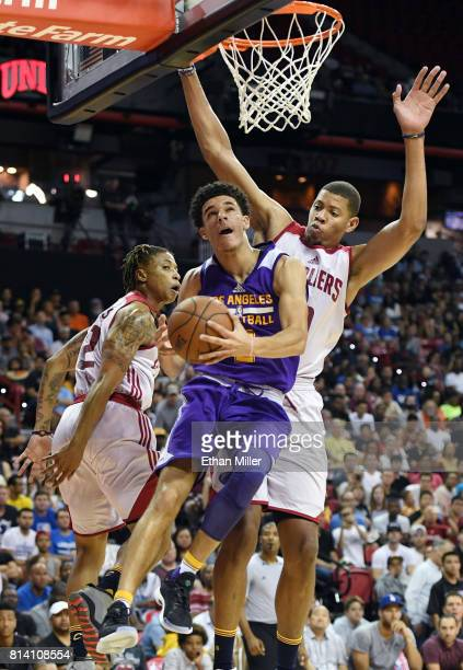 Lonzo Ball of the Los Angeles Lakers shoots a layup against TJ Williams and Edy Tavares of the Cleveland Cavaliers during the 2017 Summer League at...