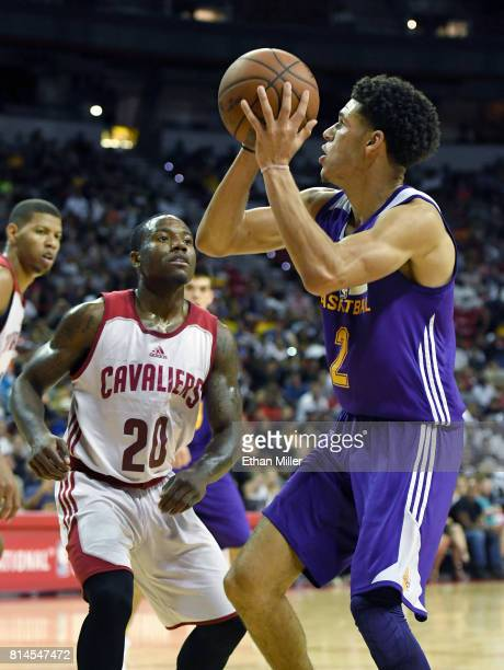 Lonzo Ball of the Los Angeles Lakers shoots against Kay Felder of the Cleveland Cavaliers during the 2017 Summer League at the Thomas Mack Center on...