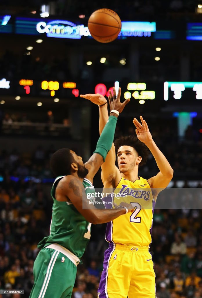 Lonzo Ball #2 of the Los Angeles Lakers shoots the ball against Kyrie Irving #11 of the Boston Celtics during the first quarter at TD Garden on November 8, 2017 in Boston, Massachusetts.