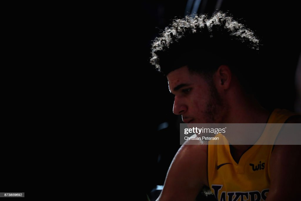 Lonzo Ball #2 of the Los Angeles Lakers sits on the bench during a time out from the second half of the NBA game against the Phoenix Suns at Talking Stick Resort Arena on November 13, 2017 in Phoenix, Arizona. The Lakers defeated the Suns 100-93.