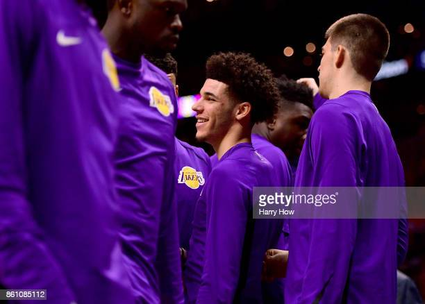 Lonzo Ball of the Los Angeles Lakers smiles from the sidelines during a timeout in the first half against the LA Clippers at Staples Center on...