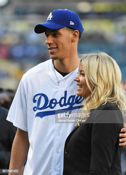 Lonzo Ball of the Los Angeles Lakers taks a photo with team owner Jeannie Buss before the game between the Los Angeles Dodgers and the Colorado...