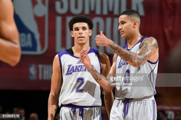 Lonzo Ball of the Los Angeles Lakers talks with Kyle Kuzma of the Los Angeles Lakers during the game against the Boston Celtics during the 2017 Las...