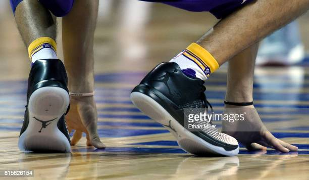 Lonzo Ball of the Los Angeles Lakers wears Nike Air Jordan XXXI sneakers as he stretches on the court before a semifinal game of the 2017 Summer...