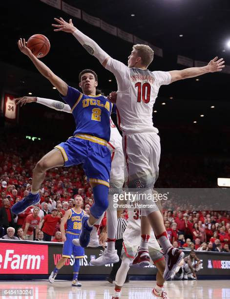 Lonzo Ball of the UCLA Bruins attempts a shot against Lauri Markkanen of the Arizona Wildcats during the second half of the college basketball game...