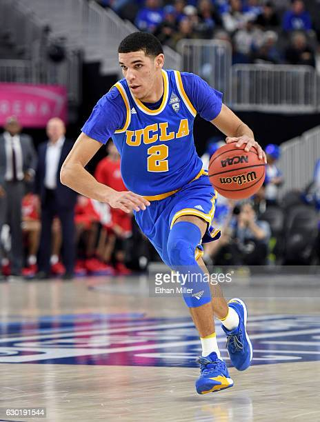 Lonzo Ball of the UCLA Bruins brings the ball up the court against the Ohio State Buckeyes during the CBS Sports Classic at TMobile Arena on December...