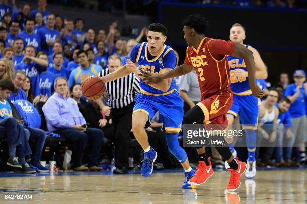Lonzo Ball of the UCLA Bruins dribbles past Jonah Mathews of the USC Trojans during the second half of a game at Pauley Pavilion on February 18 2017...
