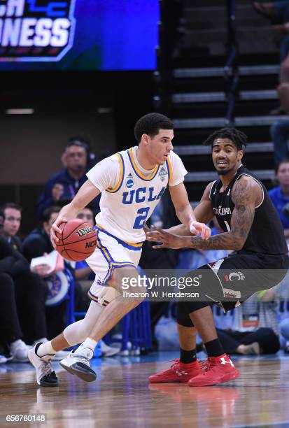 Lonzo Ball of the UCLA Bruins drives on Jacob Evans of the Cincinnati Bearcats during the second round of the 2017 NCAA Men's Basketball Tournament...