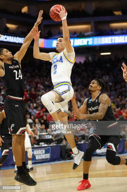 Lonzo Ball of the UCLA Bruins drives to the basket against Kyle Washington of the Cincinnati Bearcats during the second round of the 2017 NCAA Men's...