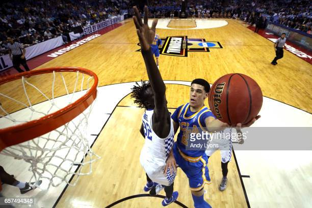 Lonzo Ball of the UCLA Bruins drives to the basket against Wenyen Gabriel of the Kentucky Wildcats in the first half during the 2017 NCAA Men's...