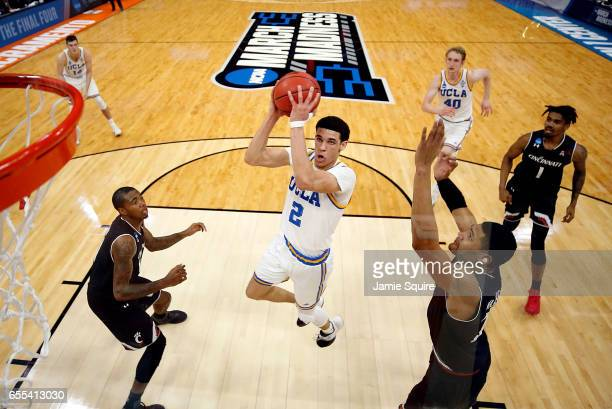 Lonzo Ball of the UCLA Bruins drives to the basket as Kyle Washington of the Cincinnati Bearcats defends during the second round of the NCAA...