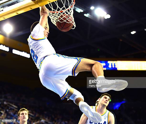 Lonzo Ball of the UCLA Bruins dunks in front of Gyorgy Goloman as Maxwell Kupchak of the UC Santa Barbara Gauchos looks on during a 10262 win over...