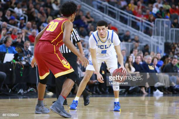 Lonzo Ball of the UCLA Bruins handles the ball against Elijah Stewart of the USC Trojans during a quarterfinal game of the Pac12 Basketball...