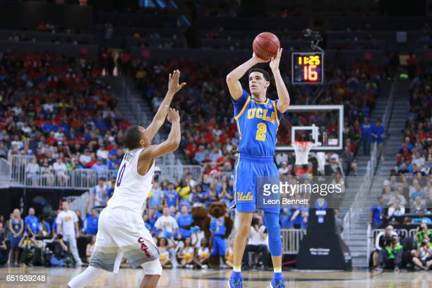 Lonzo Ball of the UCLA Bruins handles the ball against Parker JacksonCartwright of the Arizona Wildcats during a semifinal game of the Pac12...