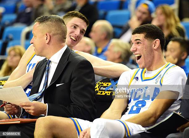 Lonzo Ball of the UCLA Bruins laughs with TJ Leaf during a 10262 win over the UC Santa Barbara Gauchos at Pauley Pavilion on December 14 2016 in Los...