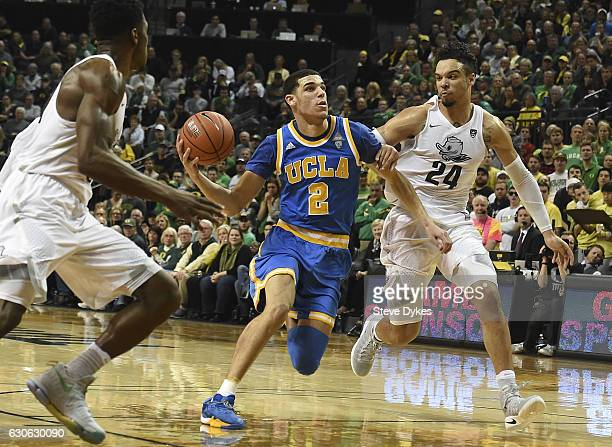 Lonzo Ball of the UCLA Bruins tries to get around Dillon Brooks of the Oregon Ducks late in the game at Matthew Knight Arena on December 28 2016 in...