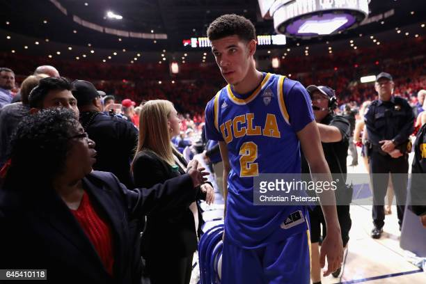 Lonzo Ball of the UCLA Bruins walks off the court after defeating the Arizona Wildcats in the college basketball game at McKale Center on February 25...