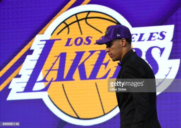 Lonzo Ball walks on stage after being drafted second overall by the Los Angeles Lakers during the first round of the 2017 NBA Draft at Barclays...