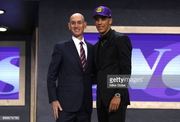 Lonzo Ball walks on stage with NBA commissioner Adam Silver after being drafted second overall by the Los Angeles Lakers during the first round of...