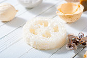 loofah sponge on white wooden