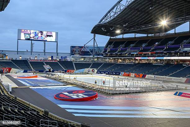 A look at field level as workers install the lines and logos into the ice surface in advance of the 2016 Tim Hortons Heritage Classic on October 18...