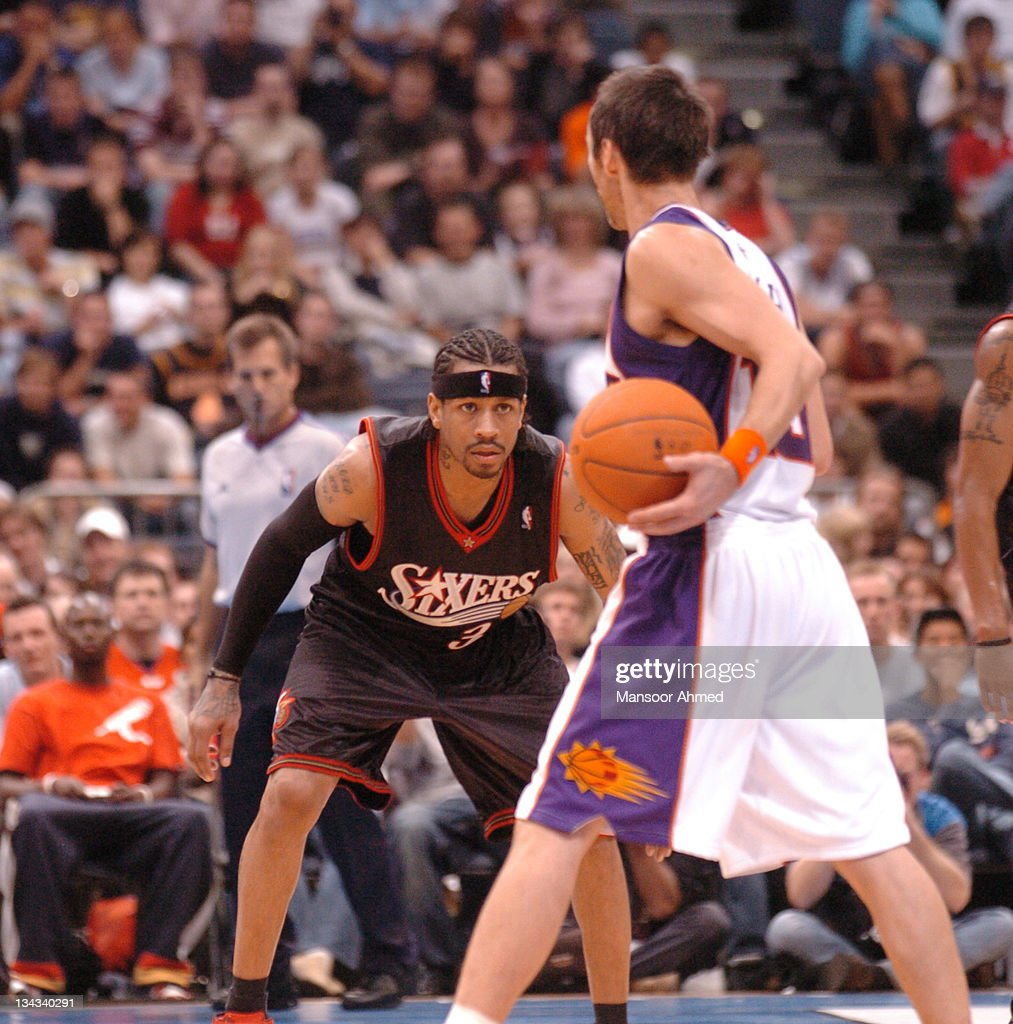 Look of concetration on the eyes of Philadelphia's Allen Iverson as he tries to guard Steve Nash of Phoenix during the NBA Europe Live Tour presented...
