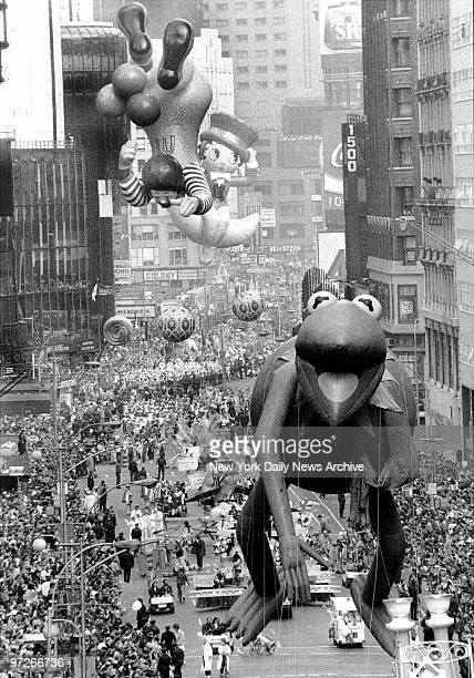 Look up in the sky it's Kermit topsyturvy Ronald McDonald and Betty Boop astride crescent moon in the Macy's Thanksgiving Day Parade