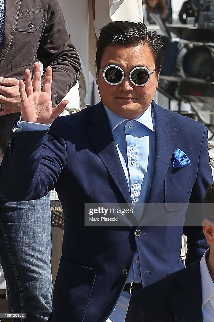 A PSY lookalike is seen arriving at the 'Martinez' beach during the 66th Annual Cannes Film Festival on May 20, 2013 in Cannes, France.