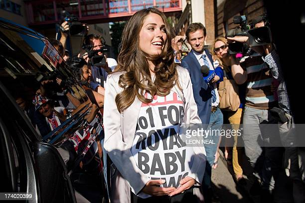 A lookalike of Catherine Duchess of Cambridge becomes the centre of attention for the assembled media outside the Lindo Wing of St Mary's Hospital in...