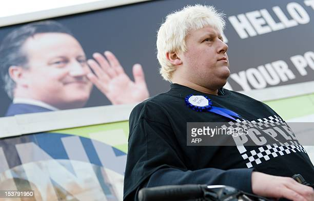 A lookalike of Mayor of London Boris Johnson takes part in a protest about proposed cuts in the police service on the third day of the annual...