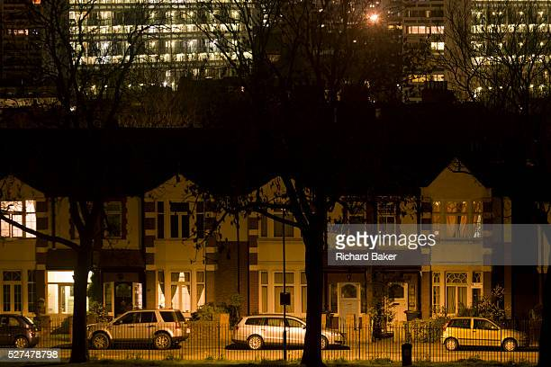 Looking across south London towards Edwardian homes and block of flats in the darkness of the suburbs It is late one evening in central London in a...