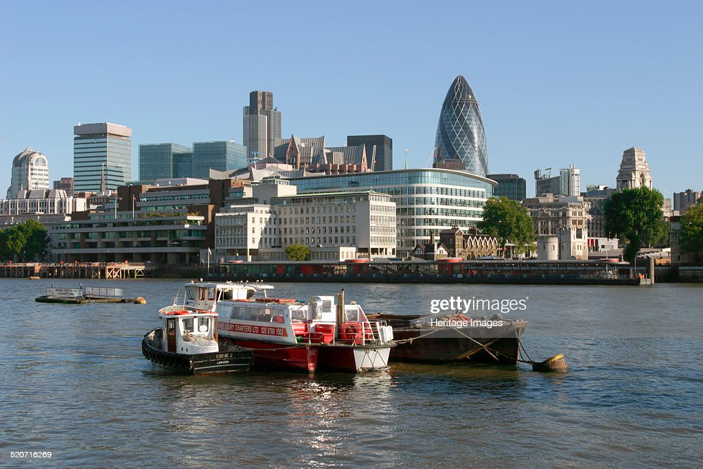 Looking across the Thames towards the City of London The two tallest buildings are Tower 42 and Sir Norman Foster's 'Gherkin' built for the Swiss Re...