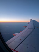 Looking At Airplane Wing At SunRise Through the Window