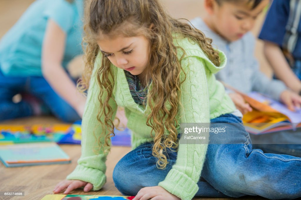 Looking at Books in Class : Stock Photo